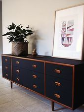 A Danish Schreiber sideboard painted in black – this highlights the handles and …