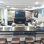 A narrow counter height bar behind a sectional in a rustic chic basement remodel… - worldefashion.com/decoration