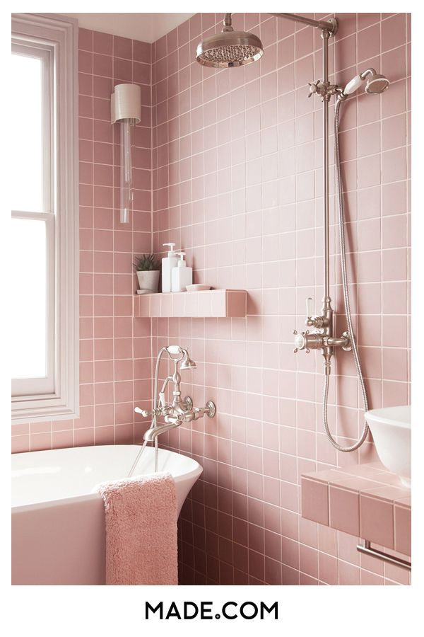 A pink tiled bathroom is never too much. Mix with chrome accessories for a styli…