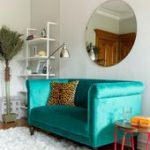 A teal settee invites a pop of fun youthful color into this room along with a l#...