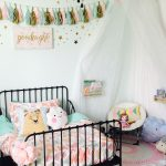 Girly girl room. IKEA toddler bed. Target bedding. IKEA canopy made into a readi...