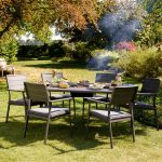 Impress your guests with the Jamie Oliver Caraway Firepit Set and cook their foo...