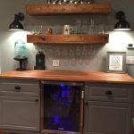 Rustic bar with IKEA cabinets and beverage center #basementbar