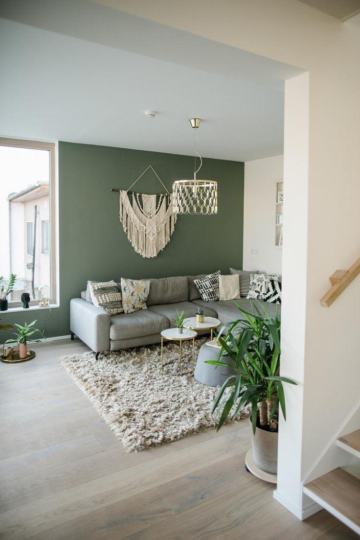 Salon avec peinture murale verte – Peinture