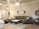 Sherwin Williams Agreeable Gray in living room with gray sectional couch and are…