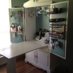 TV Armoire turned into a sewing cabinet with fold up table by katharine