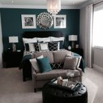 Teal & grey bedroom with loveseat as footboard.