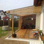 Terrassendach mit Glasschiebewänden | geschloßene Verglasungen