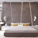 The angular upholstered headboard in this modern bedroom almost takes up the entire wall