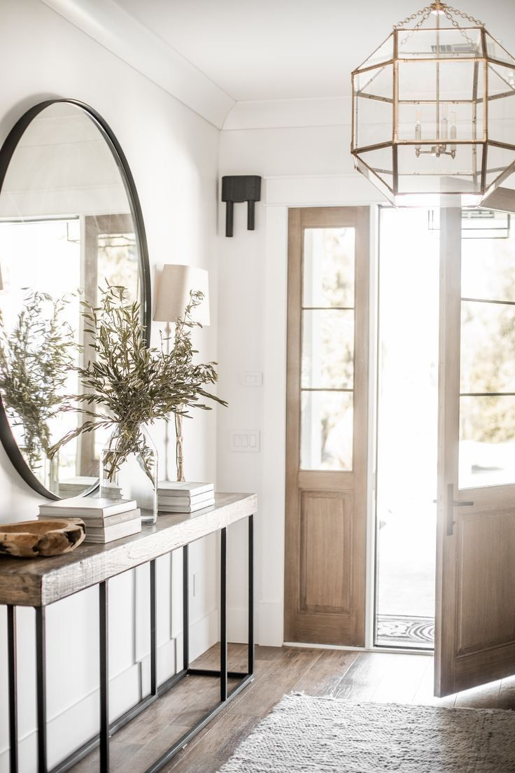 Traditional entry with large round mirror and sofa table #entryway #modernhome