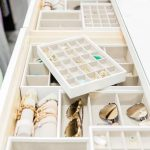 White custom closet dresser boasts jewelry drawers filled with The Container Sto...